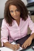 Beautiful Mixed Race African American Female Student Or Businesswoman Writing