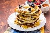 image of ooze  - Big Pile of American Blueberry Pancakes with Berries and Maple Syrup - JPG