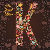 The letter K. Bright floral element of colorful alphabet made from birds, flowers, petals, hearts an
