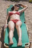 Woman In Bikinis Sunbathing