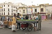 CASABLANCA, MOROCCO - OCTOBER 14 2013: Merchant is selling avocados in the streets of Casablanca Mor