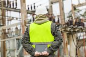 picture of substation  - Electrical Engineer in electrical substation in winter - JPG
