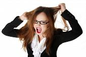 pic of pulling hair  - Stressed business woman is going crazy pulling her hair in frustration - JPG