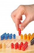 picture of chinese checkers  - woman hand playing a game of Chinese checkers - JPG