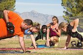 picture of rep  - Instructor holding stopwatch while teaching bootcamp fitness - JPG