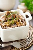 stock photo of buckwheat  - Buckwheat porridge with mushrooms in a bowl - JPG