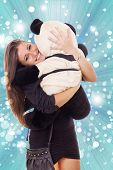 Smiling Thrilled Business Woman Hugging Teddy Bear
