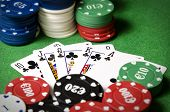 foto of flush  - royal flush of shamrocks between betting chips - JPG