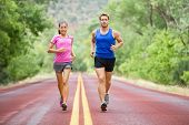 stock photo of fitness man body  - Fitness sport couple running jogging outside on road beautiful nature landscape - JPG