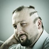 foto of half-shaved hairstyle  - Man with funny silly half bald hair - JPG