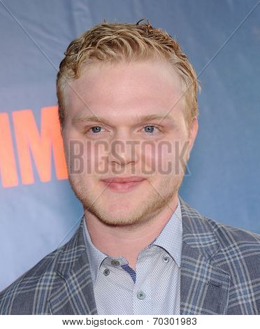 LOS ANGELES - JUL 17:  Joe Adler arrives to the CBS-CW-Showtime Summer TCA Press Tour 2014  on July7, 2014 in West Hollywood, CA.