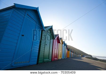 Row Of Colorful Wooden Beach Huts In Whitby
