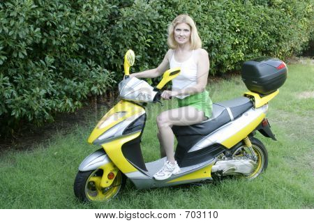 Beautiful Middle Aged Woman Driving A Scooter 2