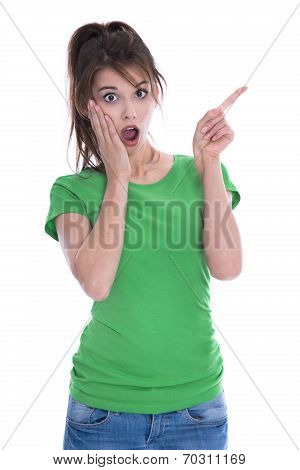 Shocked And Amazed Young Woman In Green Shirt Pointing With Her Finger.