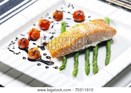 baked salmon with green asparagus and cherry tomatoes