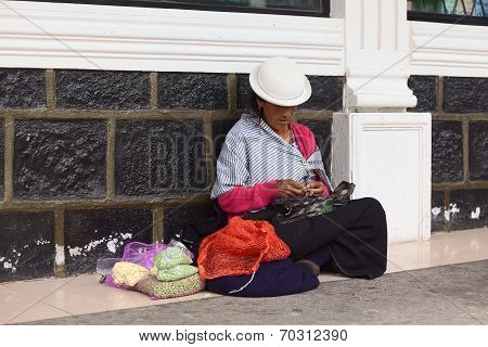Woman Selling Vegetables in Banos, Ecuador