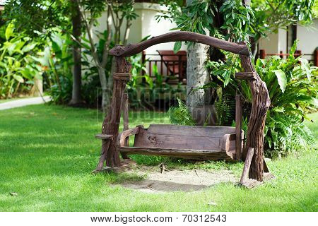 Old Wood Swing In The Green Garden