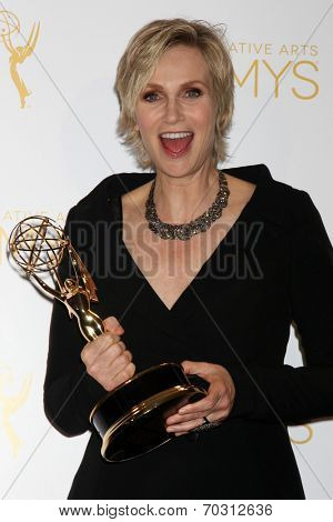 LOS ANGELES - AUG 16:  Jane Lynch at the 2014 Creative Emmy Awards - Press Room at Nokia Theater on August 16, 2014 in Los Angeles, CA