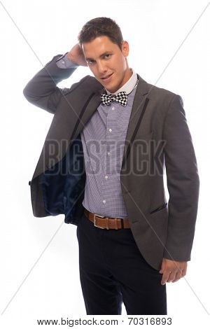 Handsome trendy young man wearing a stylish bow tie and jacket standing scratching his head with a puzzled expression, on white