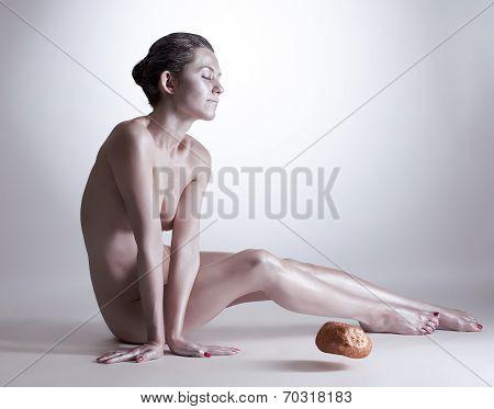 Woman moving stone without touching it
