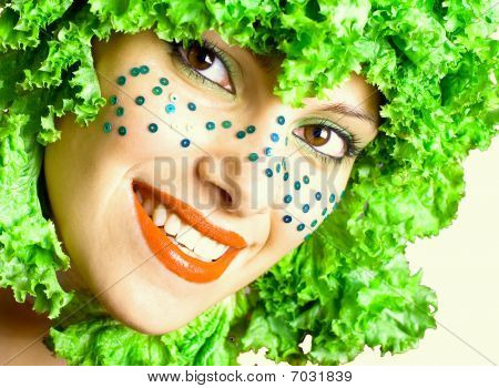 portrait of a woman with salad