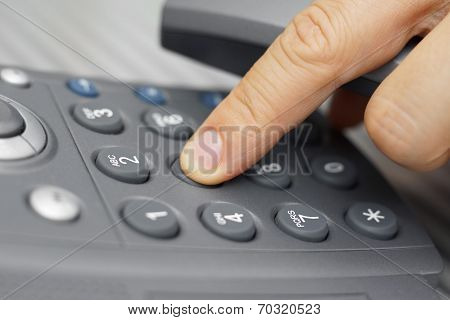 Closeup Of Man Finger Is Dialing A Telephone Number