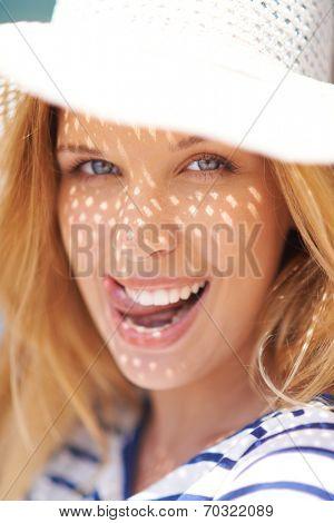Portrait of flirty woman in summer hat