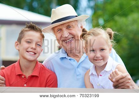 Portrait of a senior man with two grandchildren