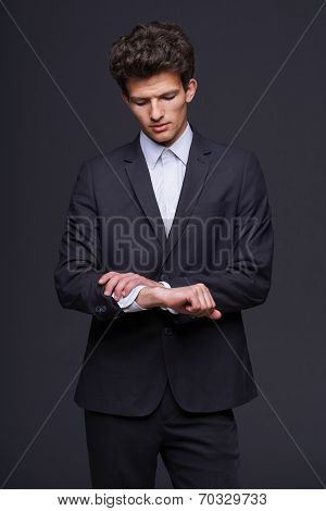 Business man looking on his wrist