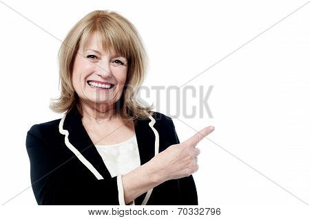 Smiling Aged Woman Pointing Away