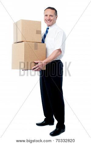 Smiling Mature Man Carrying Boxes