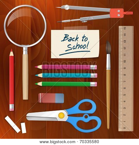 Back To School Supplies Tools On Wood Background