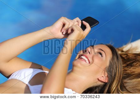 Funny Woman Using Her Smart Phone In Summer Vacations