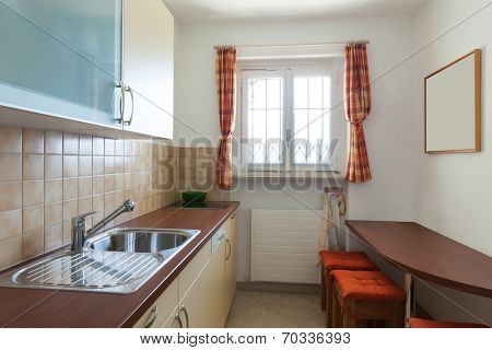 small domestic kitchen of a house, interior