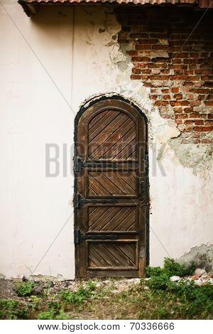 Old Medieval Door In The Destroyed Building