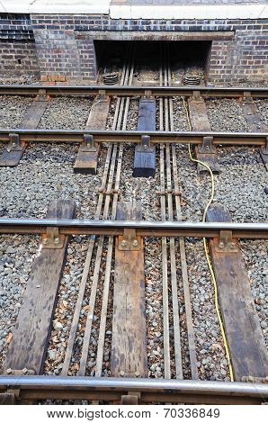 Points rods from signal box under rail track.