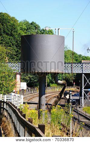 Water tower alongside railway line.