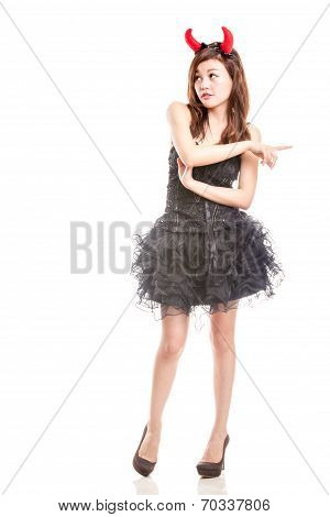 Chinese Woman In Black Dress And Devil Horns Pointing