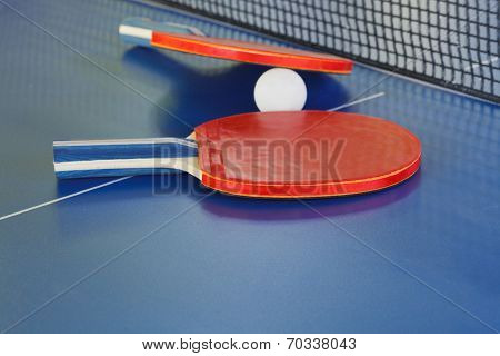 Two Paddle, Tennis Ball On Blue Ping Pong Table