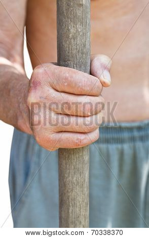 Peasant Holds Old Wooden Tool Handle