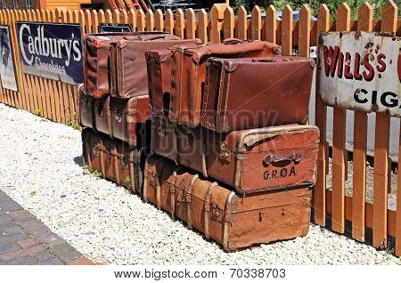 Old leather suitcases on railway platform.