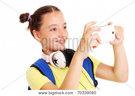 A picture of a schoolgirl taking pictures with her smartphone