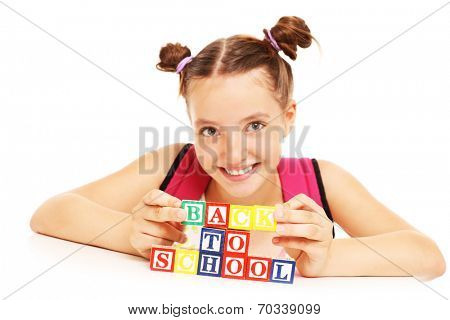 A picture of a schoolgirl with back to school blocks