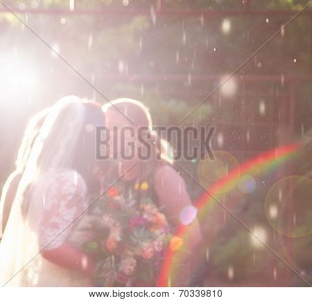 two women getting married in the rain (super soft image)