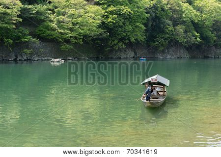 KYOTO, JAPAN - APRIL 26th  : The ferry of  Hozu(Katsuragawa) River in Arashiyama in Kyoto, Japan on 26th April 2014.