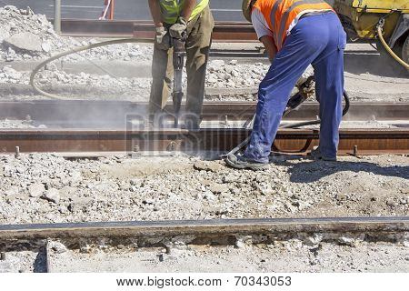 Two Workers With Pneumatic Hammer