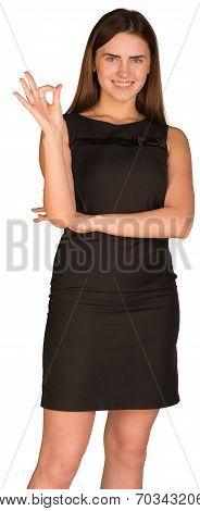 Businesswoman showing ok hand symbol
