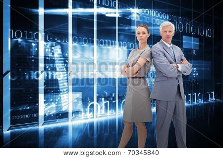 Serious businessman standing back-to-back with a woman against hologram interface in office overlooking city