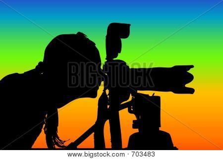 Silhouette Of A Woman With Camera