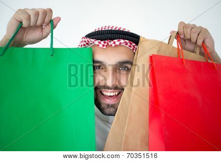 Arabic young businessman with shopping bags